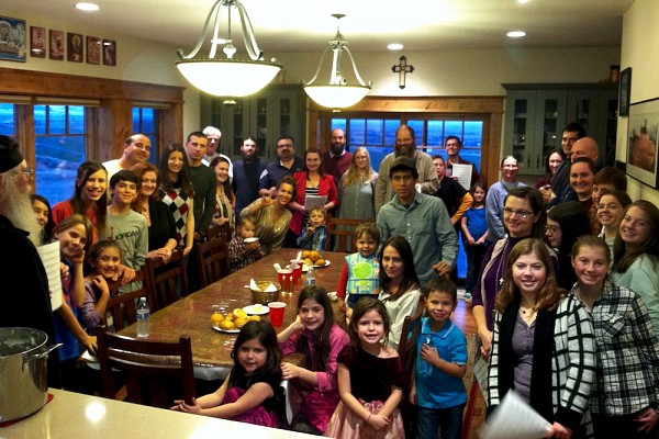 Parishioners gather for an early Thanksgiving meal before the Advent fast begins.
