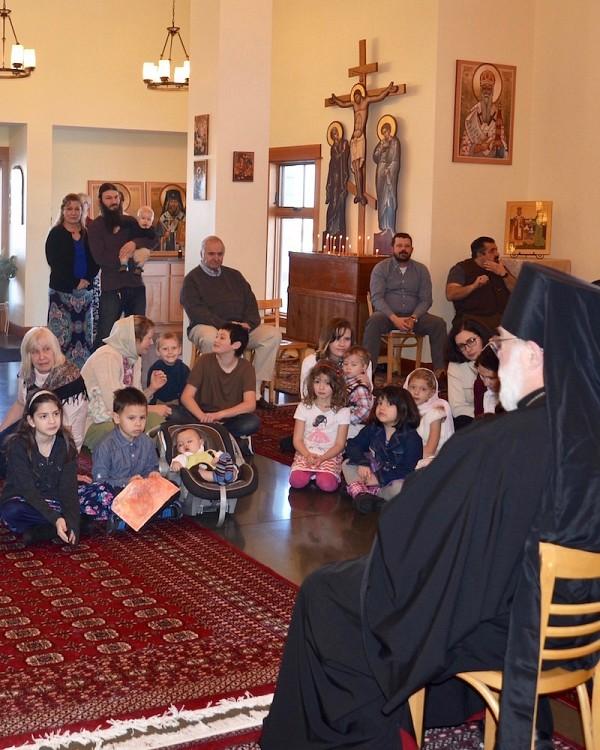 Parishioners listen to Archbishop BENJAMIN.